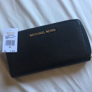 Authentic MK Jet Set Wallet